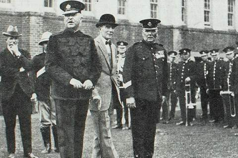 Captain Chaffey (Chief Secretary), Inspector Colmer, Commissioner Childs, Sir Phillip Game, and Sergeantt. J . W a lsh.